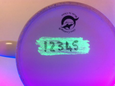 Under UV light - the 'top coat' B67 varnish contains a unique forensic signature assigned to the particular Museum